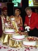 Asian Wedding Toastmaster at the cake cutting