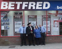 Some of the great staff at Betfred in Redhill Surrey with the Town Crier, Richard Palmer