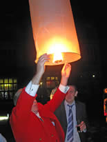 Toastmaster Richard Palmer at a wedding reception launching chinese lanterns