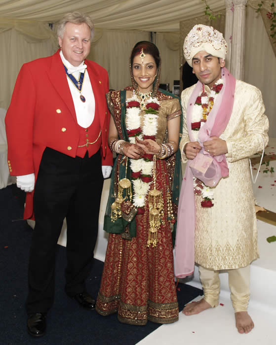 Hindu Toastmaster with bride and groom at Parklands in Essex