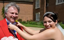 Toastmaster Richard Palmer getting a helping hand from a very happy bride