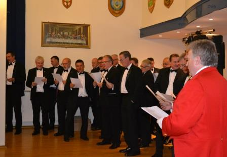 Toastmaster singing the Ladies Song as part of the chior