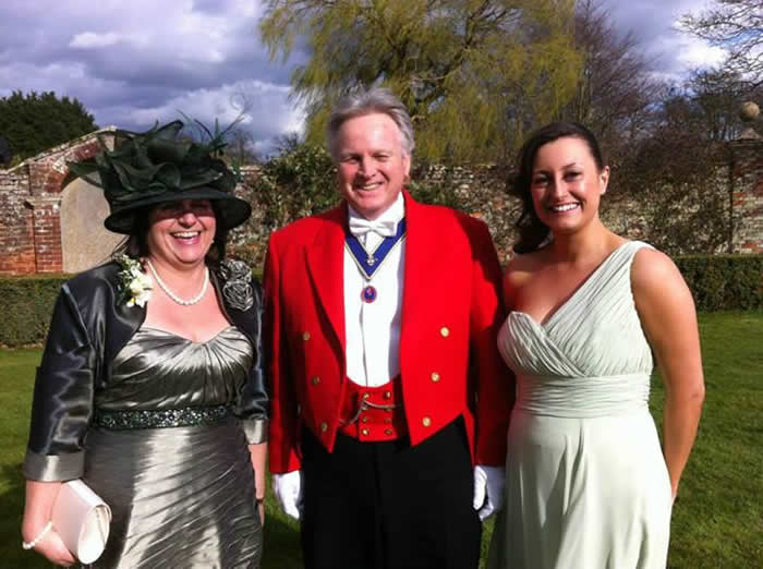 Toastmaster with the mother and sister of the groom