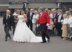 Wedding toastmaster Richard Palmer with bride and bridegroom at Channels Golf Club